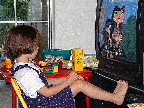 child watching a toilet training cartoon