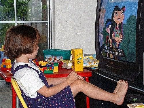child watching a toilet training cartoon